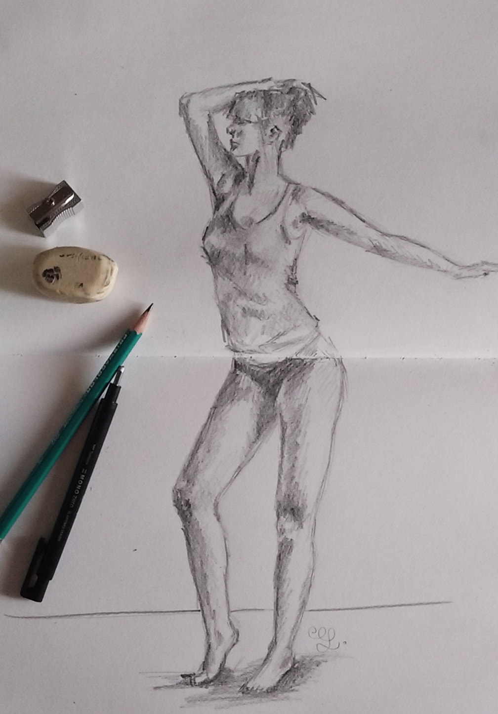 Female pose study 1. Pencil sketch by Erika Lancaster.